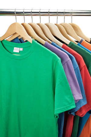 shirts on hangers: Colorful t-shirts on the hanger  Stock Photo