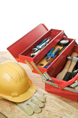 Yellow helmet and tool box. photo