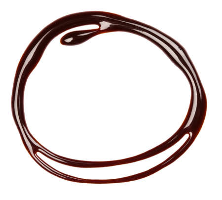 in syrup: Jarabe de chocolate de fondo por goteo, aislado Foto de archivo