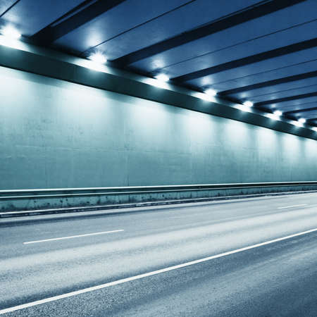 Tunnel road area with spotlights. Toned in blue. Stock Photo - 11764851