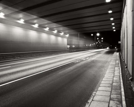 parking garage: Tunnel road area at night with a smooth car lights trace.
