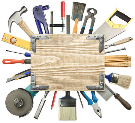 construction level: Carpentry, construction background. Tools underneath the wood plank. Stock Photo