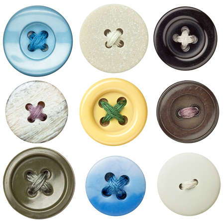 Various sewing buttons with a thread. photo