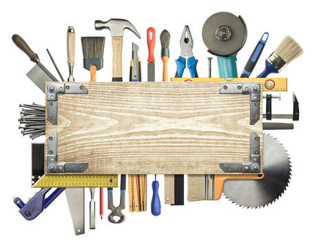 Carpentry, construction background. Tools underneath the wood plank. Фото со стока