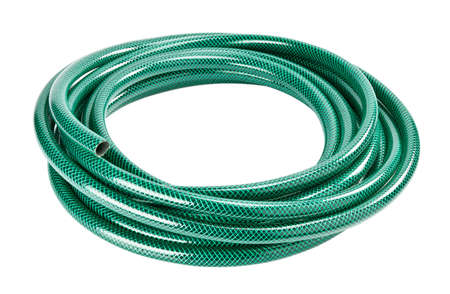 hose: Green coiled rubber hose isolated on white