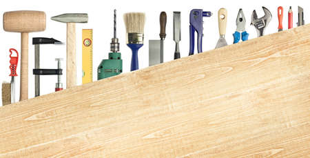 Carpentry, construction background  Tools underneath the wood plank  Stock Photo - 12781904