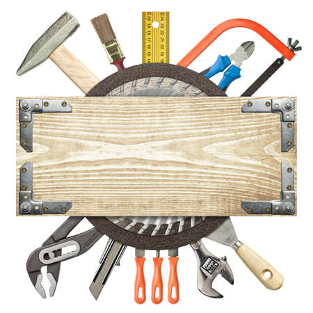 Carpentry, construction background. Tools underneath the wood plank. Stock Photo