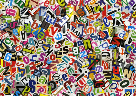 Handmade alphabet collage of magazine letters photo