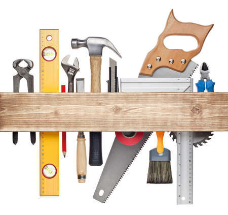 tool kit: Carpentry, construction hardware tools underneath the wood plank
