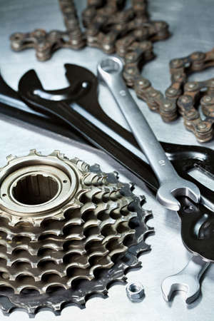 Bike repairing. Spare parts and tools. photo