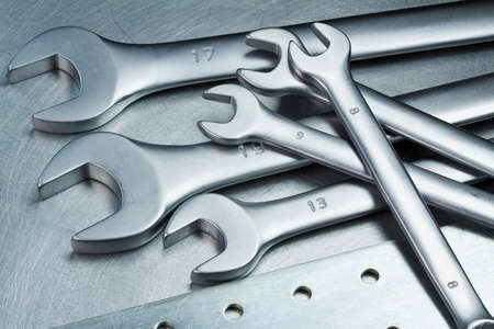 Spanners, wrenches on a metal table photo