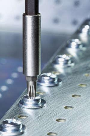 Metal workshop  Electric screwdriver  photo