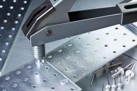 Metal workshop  Rivet gun, applicator and rivets  photo