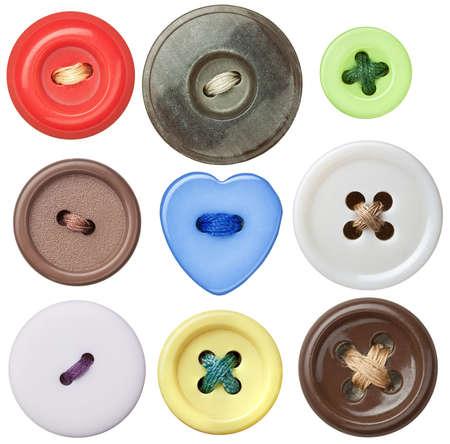 coser: Hay varios botones de coser con un hilo. Foto de archivo