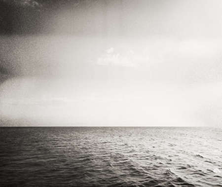 old film: Designed retro picture Abstract seascape  Grain, dust added as vintage effect