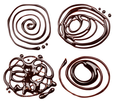 Chocolate syrup drips, isolated on white background photo