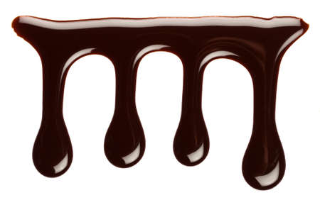Chocolate syrup drip, isolated on white background photo