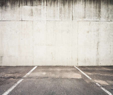 Concrete parking lot wall photo
