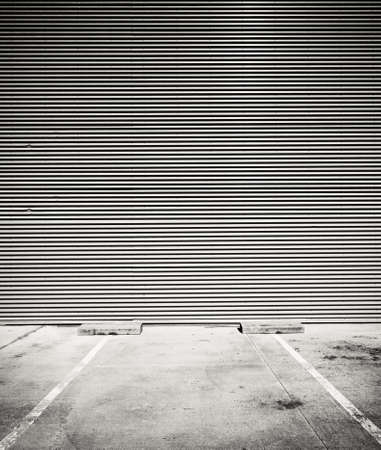 Concrete parking floor and tin wall. photo