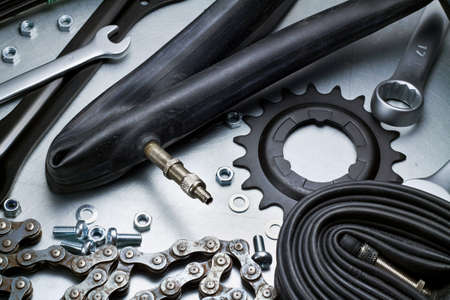 Bike repairing. Spare parts and tools. Stock Photo - 14241899