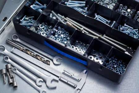 Metal workshop. Plastic toolbox with screws, bolts and some tools. Stock Photo - 14241894