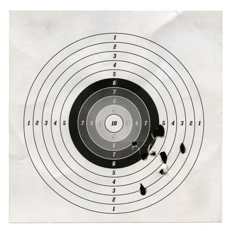 sniper training: Holes in a shooting practice target.