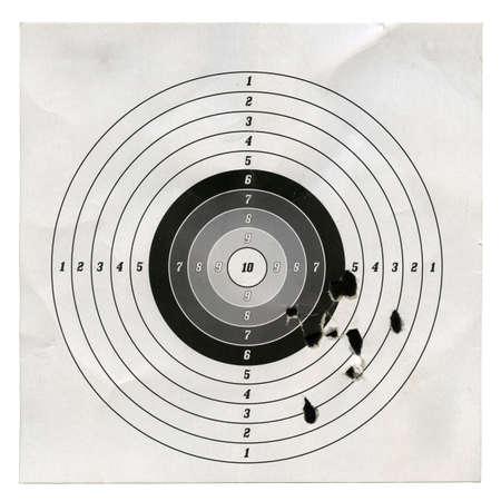 bullet: Holes in a shooting practice target.