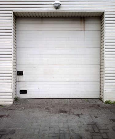 Close white garage doors photo