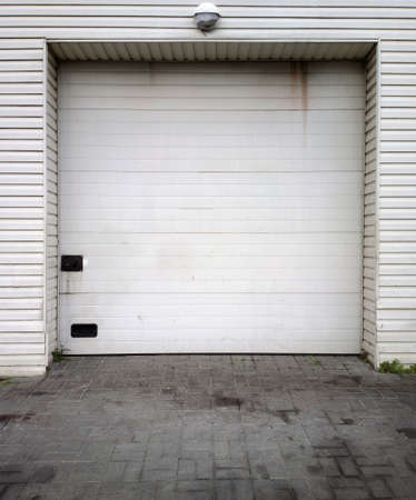 Close white garage doors photo