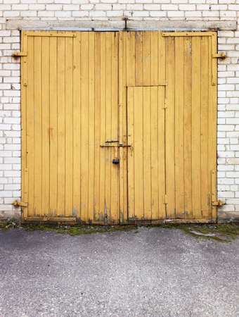 Close yellow garage doors Stock Photo - 14517616