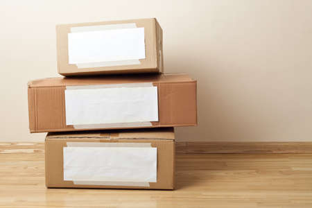 Cardboard boxes with blank labels. Moving, storage concept. photo