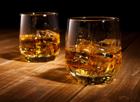 whiskey glass: Whiskey on the rocks  Stock Photo