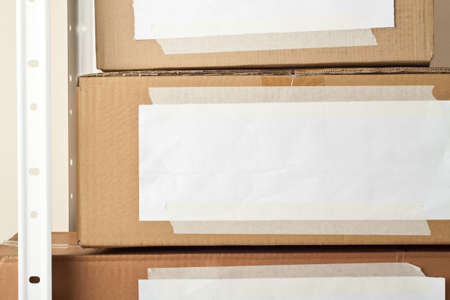 Cardboard boxes with blank labels  Moving, storage concept Stock Photo - 14752774