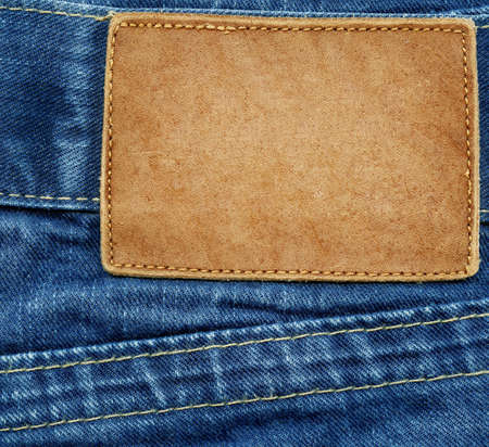 Leather jeans label sewed on jeans  photo