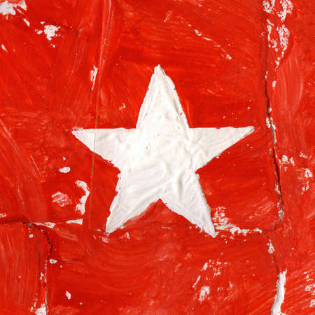 Painted acrylic white star on red  photo