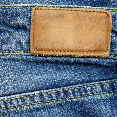 inner wear: Leather jeans label sewed on jeans  Stock Photo