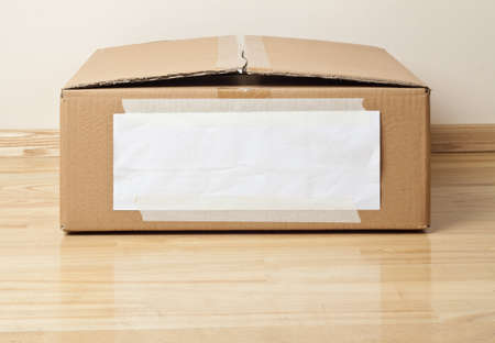 Cardboard box with blank label  Moving, storage concept  Stock Photo - 15209773