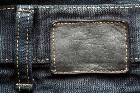 sew tags: Leather jeans label sewed on jeans