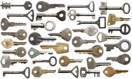 Collection of old keys, isolated  photo