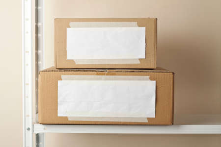 Cardboard boxes with blank labels. Moving, storage concept. Stock Photo - 15281231