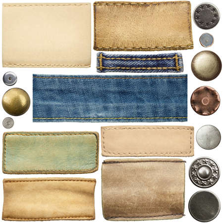 seams: Blank leather jeans labels, buttons, straps isolated on white background