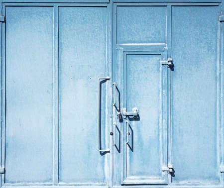 Locked blue metal warehouse doors photo