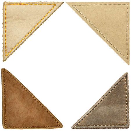 leather stitch: Triangle shape leather labels, corners.  Stock Photo