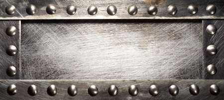 screw heads: Metal plate texture with rivets Stock Photo