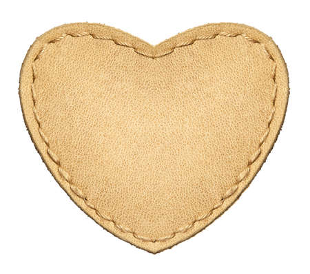 Heart shape leather label, isolated. photo