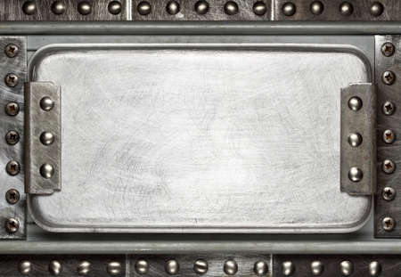Industrial metal plate background with rivets photo