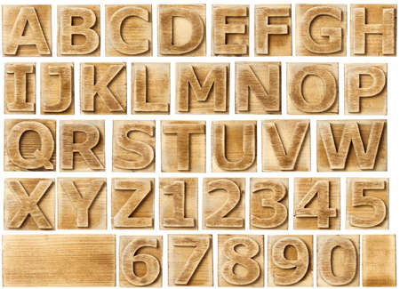 Wooden alphabet blocks with letters and numbers. photo