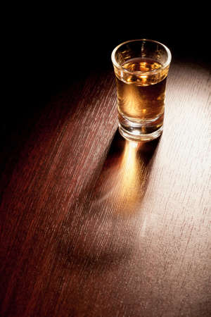 Whiskey shot in a dark bar   Stock Photo - 17095664