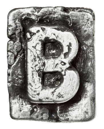 Metal alloy alphabet letter B photo