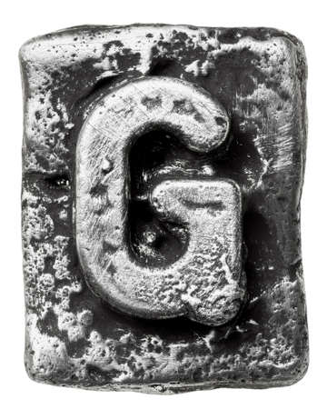 Metal alloy alphabet letter G photo